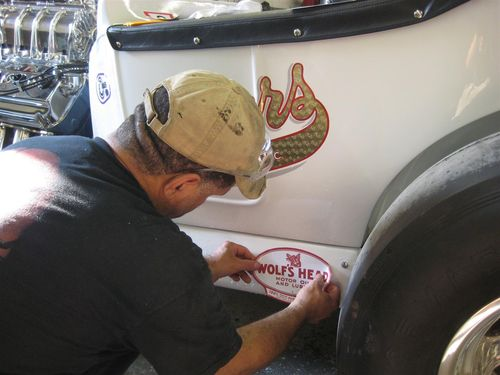 Juan places Wolf's Head decal in place
