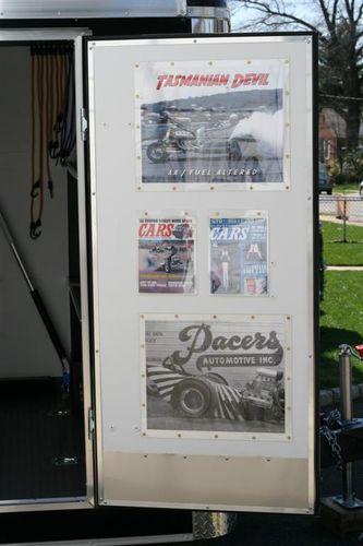 Trailer door photos behind plexiglass
